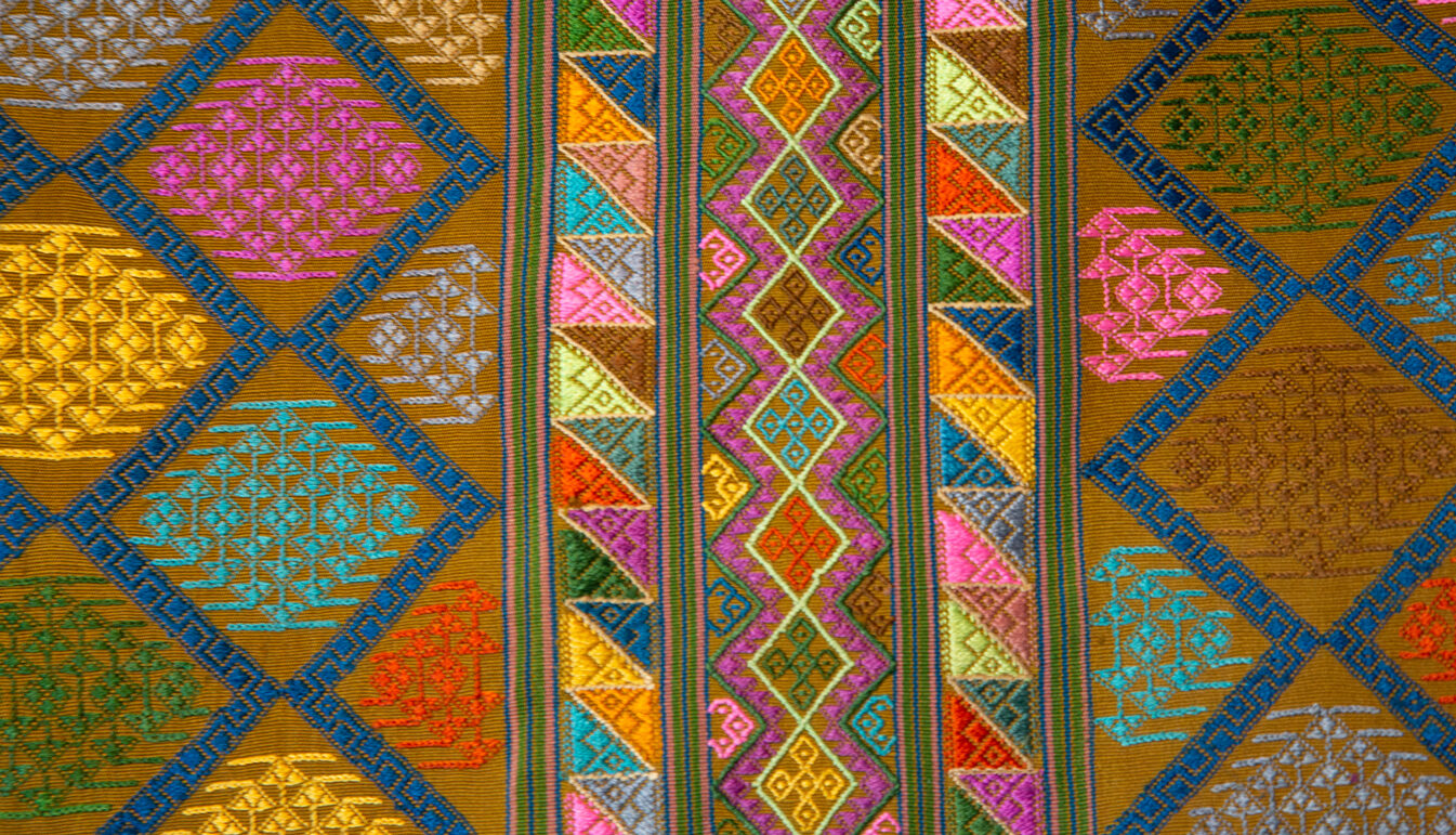 Zoom on Bhutanese Silk Woven Kira Textile, Multicolor on Brown