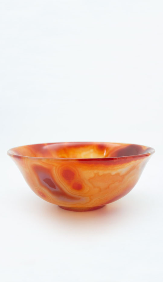 Hand caved orange agate semi-precious stone bowl, which offer calm and soothing energy