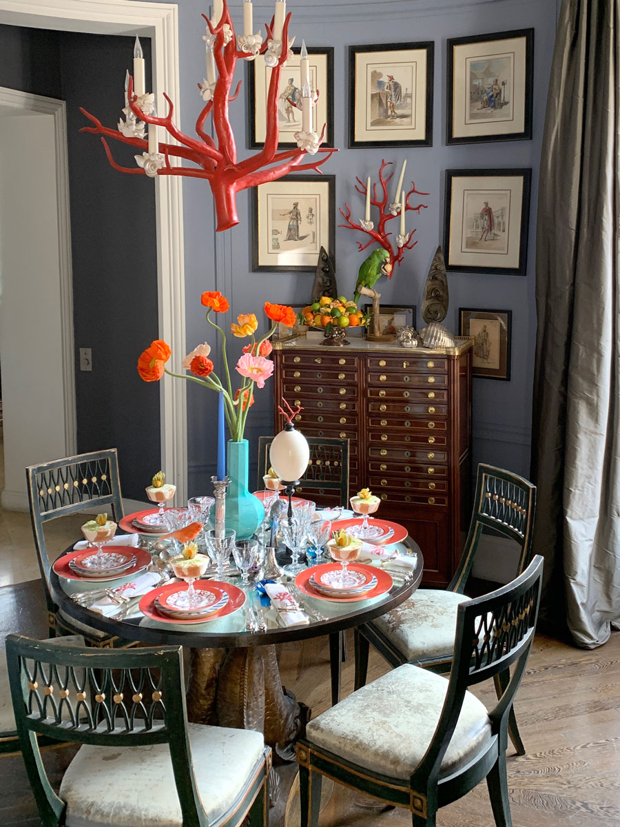 Table dressed with plates in a room