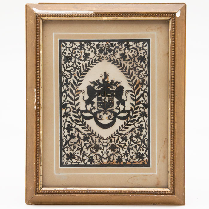 Framed Hand Cut Heraldic Shield Design. Two lions on sides of shield, with intricate floral design in gilded frame.
