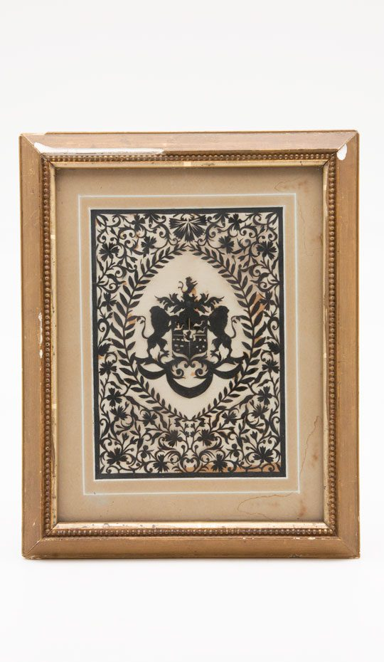 Framed Hand Cut Heraldic Shield Design. Decoration: two lions on sides of shield, with intricate floral design in gilded frame.