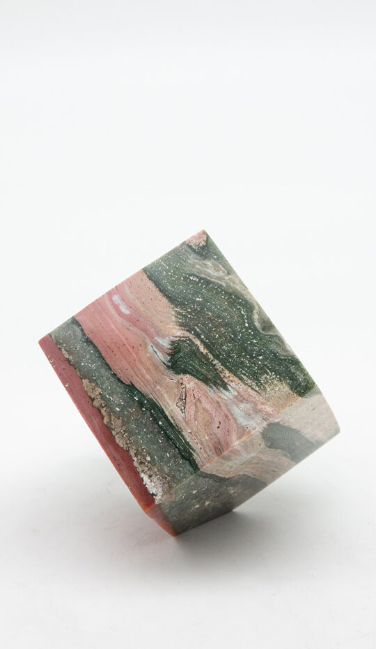 Ocean Jasper Cube Standing on Corner, Pinks and Green and Brick-red on white background