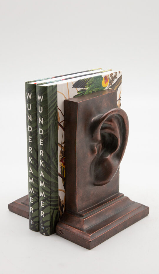 antiqued copper ear bookends holding books